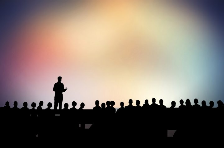 Being in front of an audience implying fear of public speaking.
