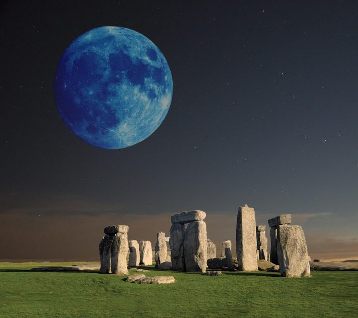 Moon above Stonehenge signifying divine inspiration in performing goals.
